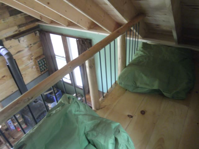 Sleeping loft.  Cots, an air mattress, and large bean bags are available.