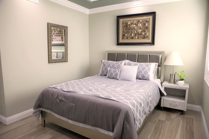 Bedroom #2: 1 furnished queen bed, 1 exit side-door to the home's backyard
