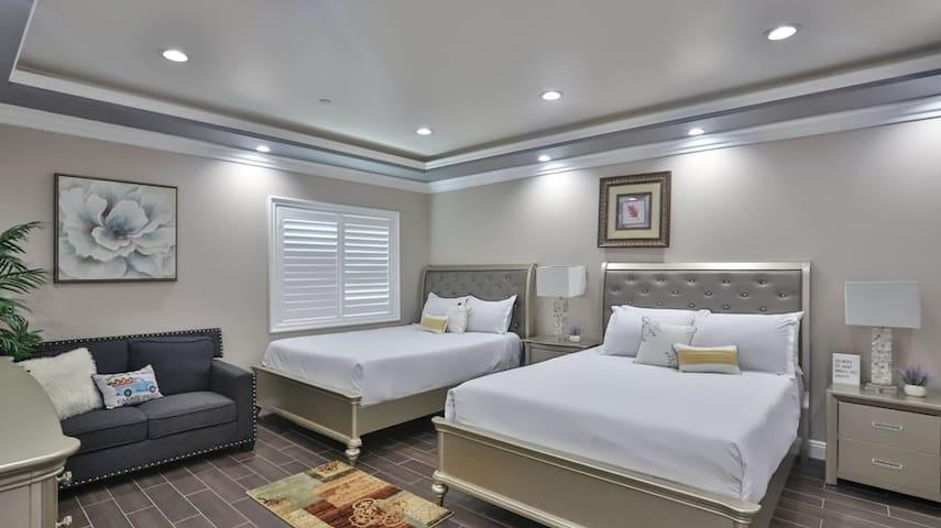 Room #1 (Master Bedroom 1): 2 queen beds, 1 couch, 1 full restroom