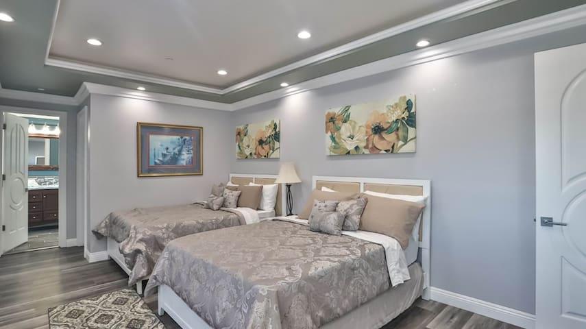 Bedroom #7 (2nd Floor): Master bedroom, 2 furnished queen beds, 1 full restroom, 1 Walk in closet, Exit to balcony
