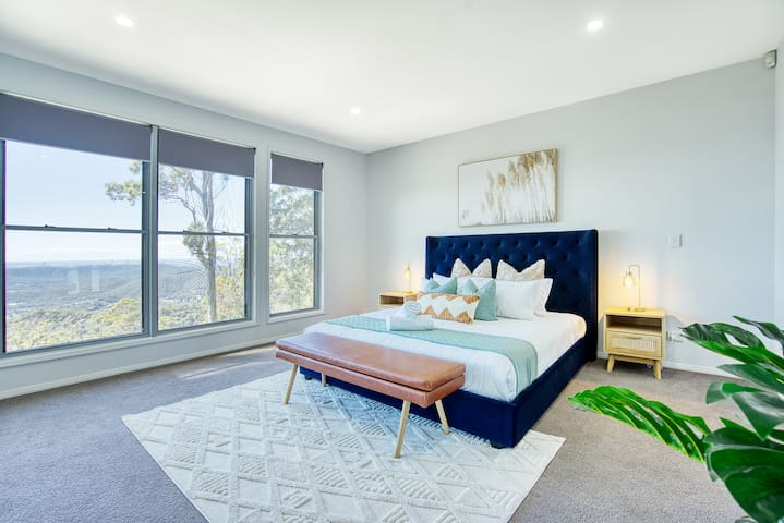 The plush master bedroom comes equipped with a king-sized bed, walk-in wardrobe and ensuite bathroom.