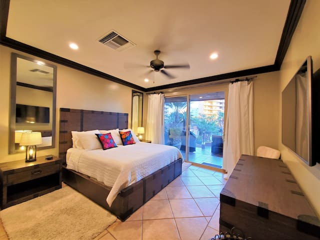 Retire to this luxuriously appointed main bedroom  furnished by Restoration Hardware. Blackout and sheer drapes help create the privacy you want while sinking into the most comfortable bed with 525 count sheets. Enjoy the views or the big screen TV.
