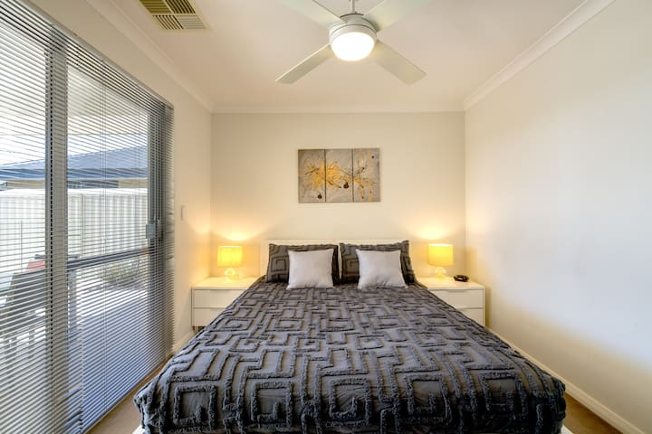 The generous second bedroom comes with a queen-sized bed and opens directly to the outdoors.