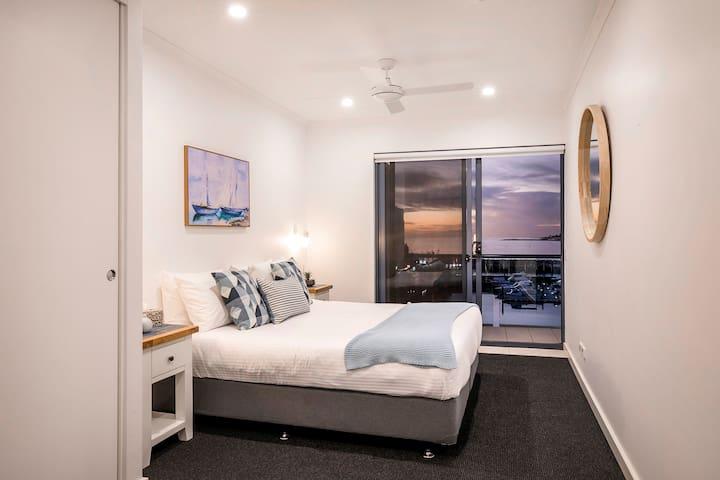 Master bedroom with balcony and romantic marina views