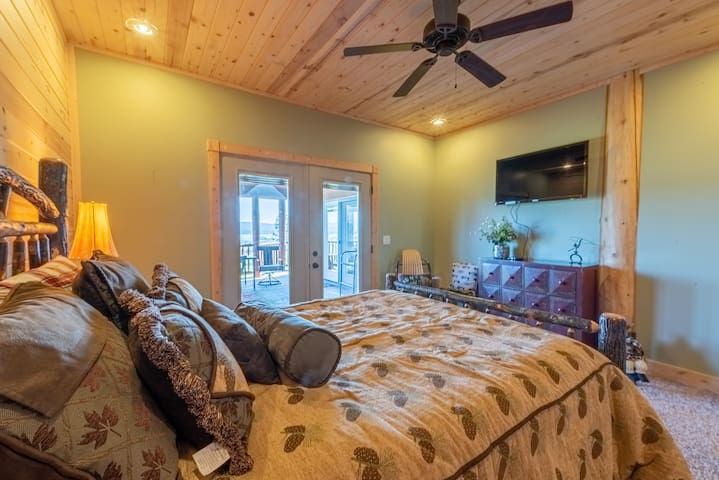 Main floor bedroom with queen size bed and access to deck