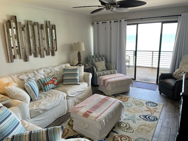 Wonderful family room for lounging, watching TV (HDMI, full cable) and playing games. Drapes are light blocking. Floor is woodlike tile. Couches are new, Cindy Crawford.