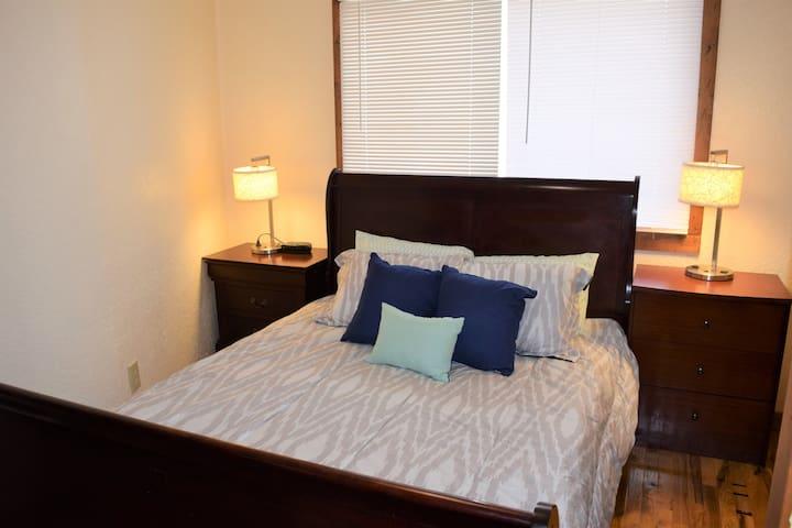 Bedroom 2: Queen size bed, dresser, closet, 2 night stands, 2 lamps, alarm clock, garbage can, hard wood floors.