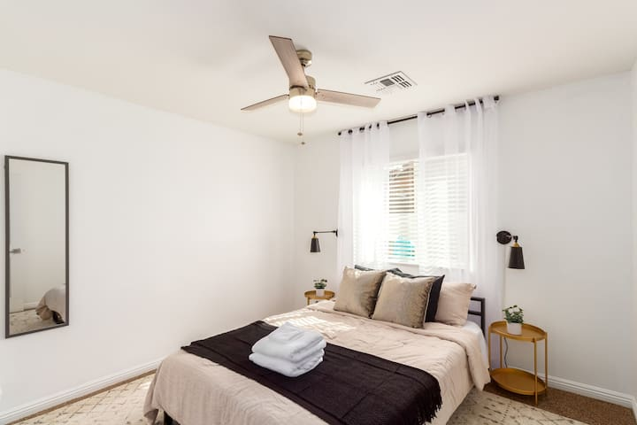 Located on the other side of the house, the third guest room has one queen bed for those wanting more privacy