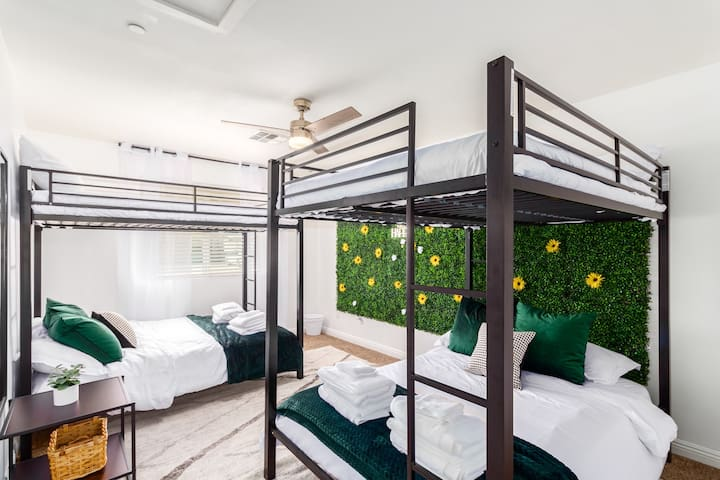 The bunk bed room features two full over full bunks, with our flower-filled grass wall for an aesthetic touch