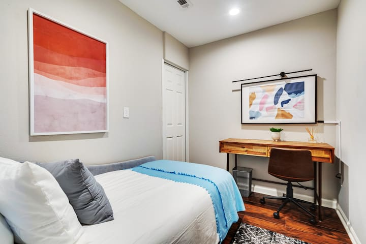 Bedroom is ideal for those with accessibility needs featuring a low profile Day Single Daybed & in-suite private bathroom with a walk-in shower. There are no stairs entering the house through the garage or only one step at the front porch