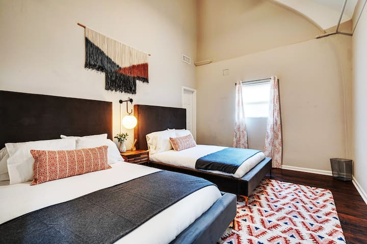 Huge Ceilings, lots of light & (2) Hotel Queen Beds with soft linens & plush pillows. Because you deserve the best night sleep, but we can't solve snoring.  Don't forget to check out it's large whimsical closet ;-)