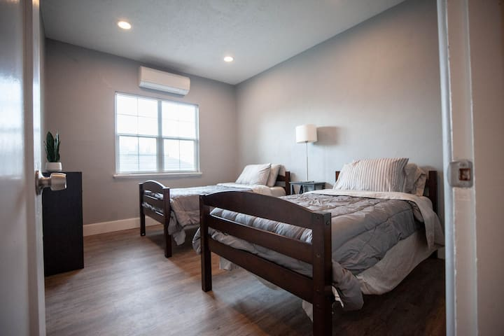 Guest room with two comfortable twin beds that can be merged together to make one large bed.  Wall mounted mini-split lets you control each rooms temperature.