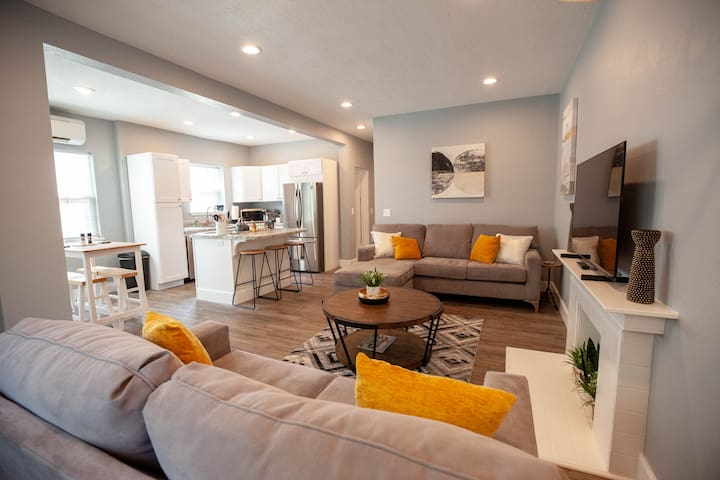 Open floor plan allows guests to interact and entertain in one large living room, dining room table, and kitchen with everything you need to cook a meal!