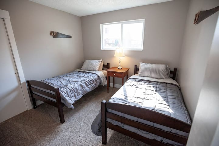 Guest room with two twin beds that can be pushed together to make one large bed.