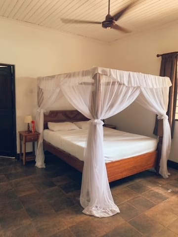 Bedroom with Queen size bed, Fan, AC and cupboard