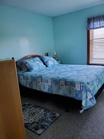 Queen bedroom with good storage.