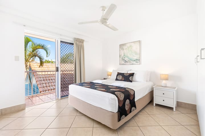 The master bedroom and enjoy a queen bed dressed in quality linen, built-in wardrobes, and direct access to a balcony