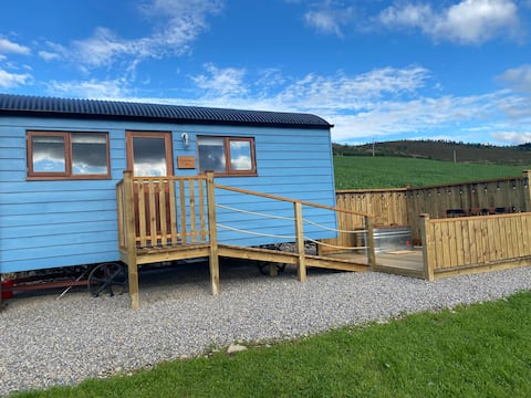 Shepherds Hut with outdoor bath on a farm stay