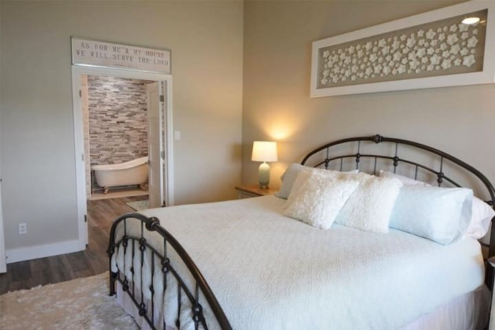 Master bedroom with attached bathroom.