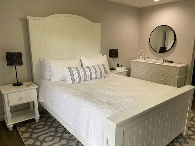 True queen size bed in bedroom