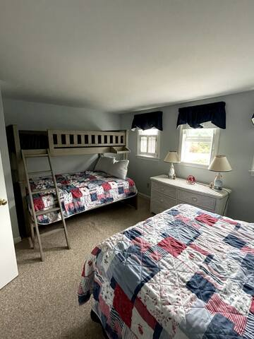 Second bedroom with a full size bed as well as a twin over full bunk bed.