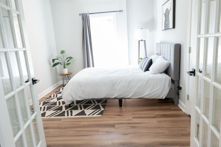 Beautiful double door queen size bedroom with large closet for your storage.