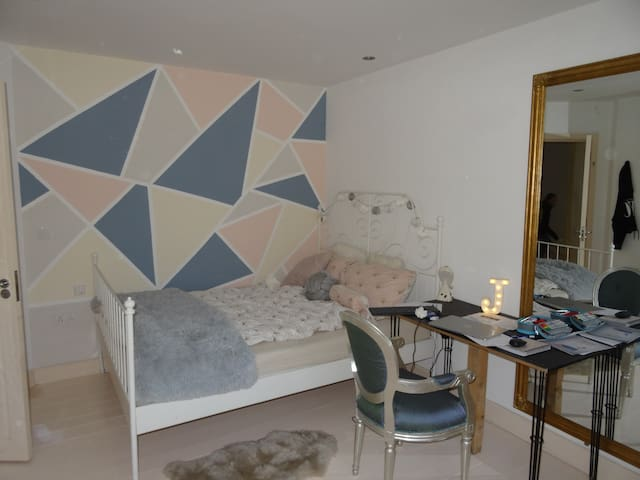 Bedroom 3 with double bed and views down the bay.