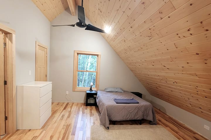 Forest views with plenty of space in our upstairs bedroom complete with walk-in closet, full en suite bathroom, and lounging areas