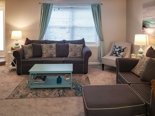 Cozy living room with modern touches and conveniences. Lamps have USB charging! Grab a book and relax.