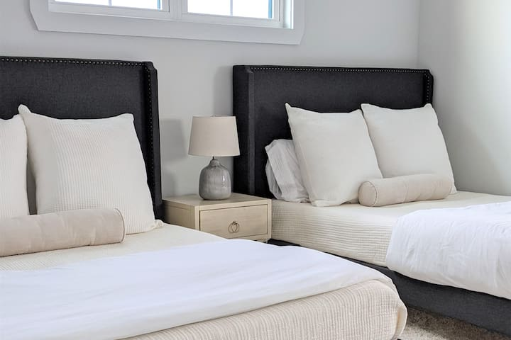 Upstairs guest room is furnished with two full size beds.  Pull down room darkening shades and a sound machine provided for a restful night sleep.
