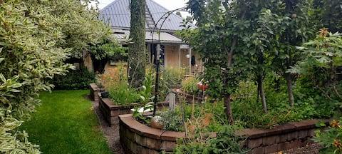 Escape to a 1 bedroom quaint garden home