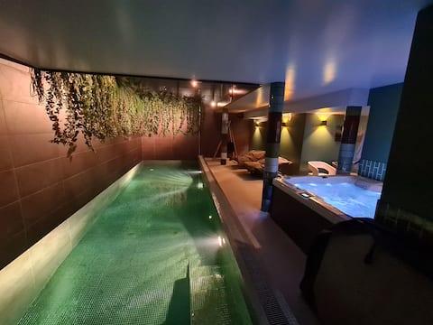 Chambre dans une villa avec forfait Spa privatif.