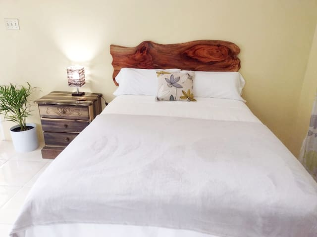 Lovely comfortable bed. Complimented by a beautiful handmade headboard.