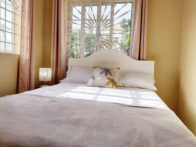 The second bedroom is Charmingly presented with a comfortable bed.