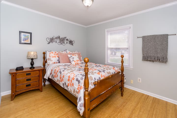 Travel to the tropics in the front bedroom. This is a double bed with high quality mattress.