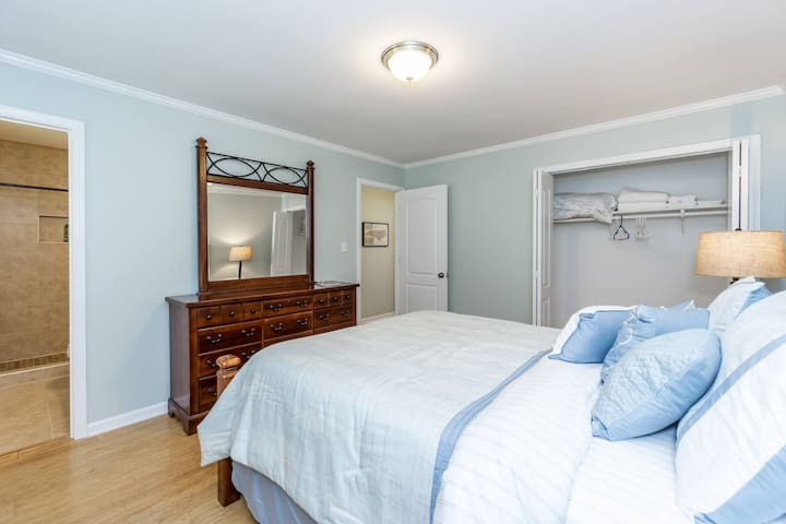 Master bedroom with step-in tiled shower. Large closet and empty dresser for all your personal belongings.