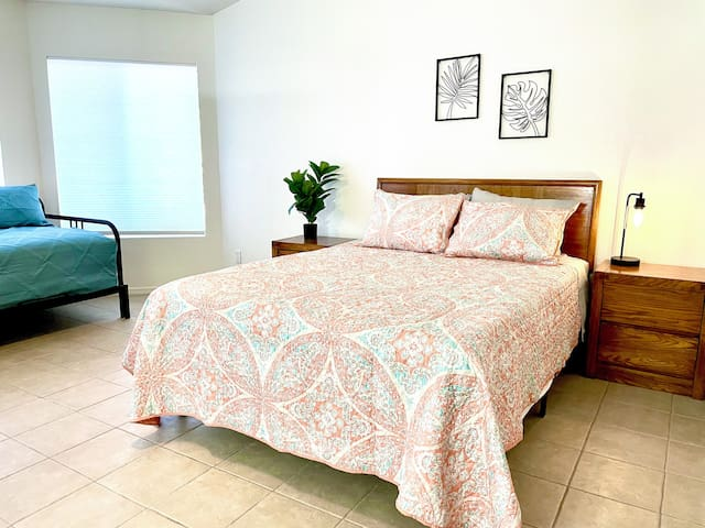Master Bedroom with Queen Bed and Daybed that Converts to a King for Additional Sleeping Arrangements