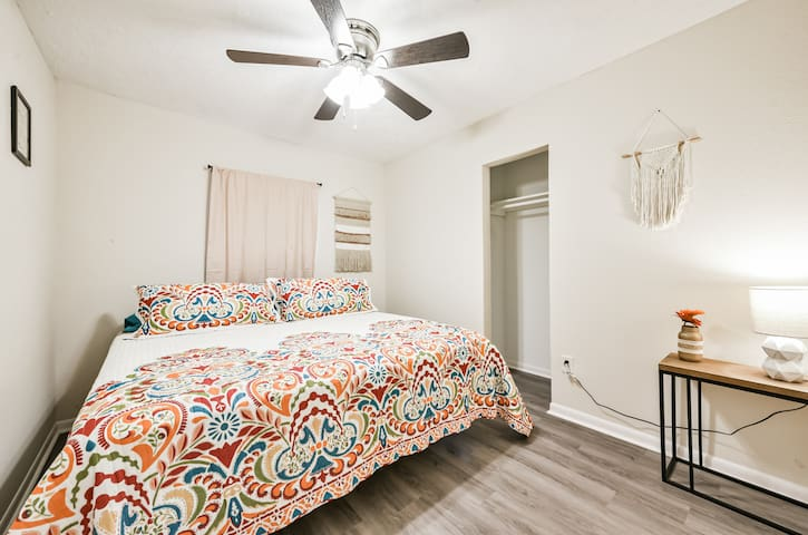 Bedroom on the right side of the house, offers a comfortable king bed with macrame decor you will love!