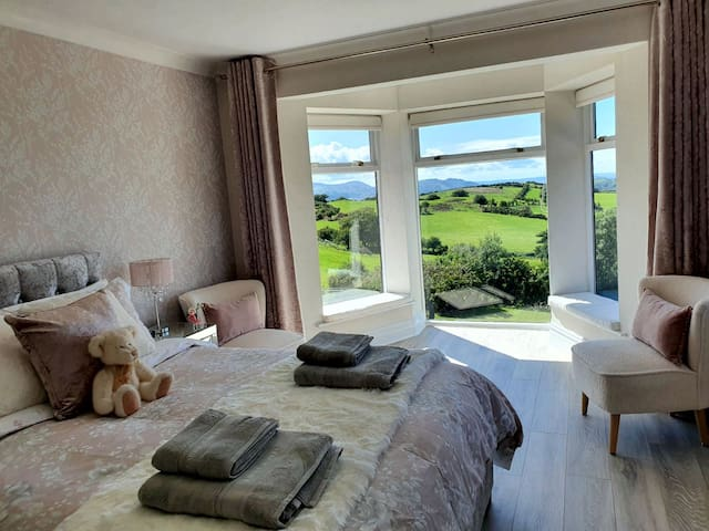 Master bedroom with stunning views from the floor-to-ceiling windows