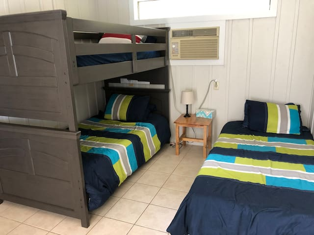 Bedroom for the kids in the guest house. Has full bath next to it
