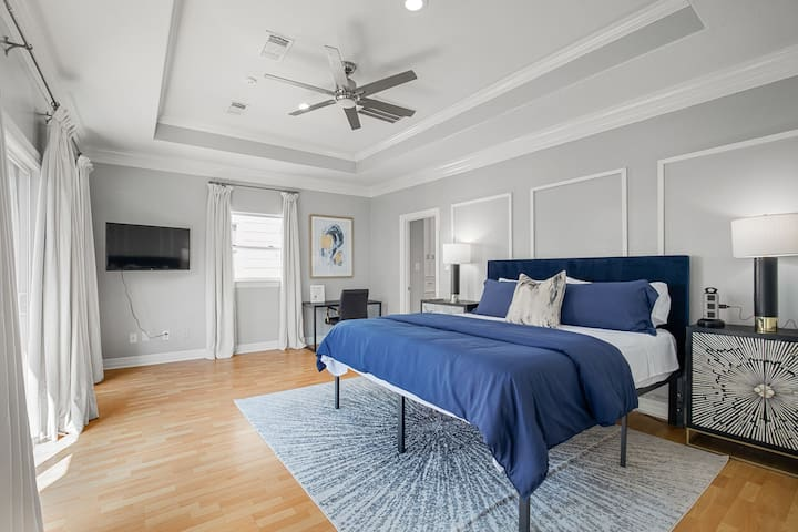 Primary bedroom is located on the 3rd floor. Super comfortable king bed and pillows with ensuite bathroom and walk-in closet