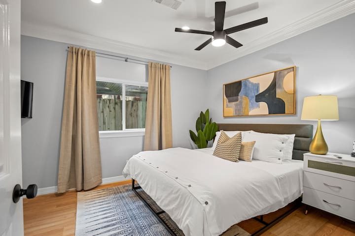 Bedroom 2 is located on the first floor. Super comfortable king bed and pillows with ensuite bathroom and walk-in closet