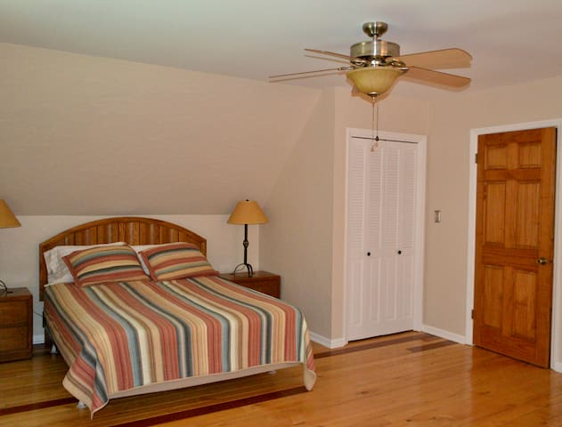 Room 2 located on top floor includes a queen bed, 2 twin beds, and a closet.