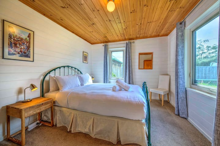 The spacious second bedroom has a comfortable queen bed.