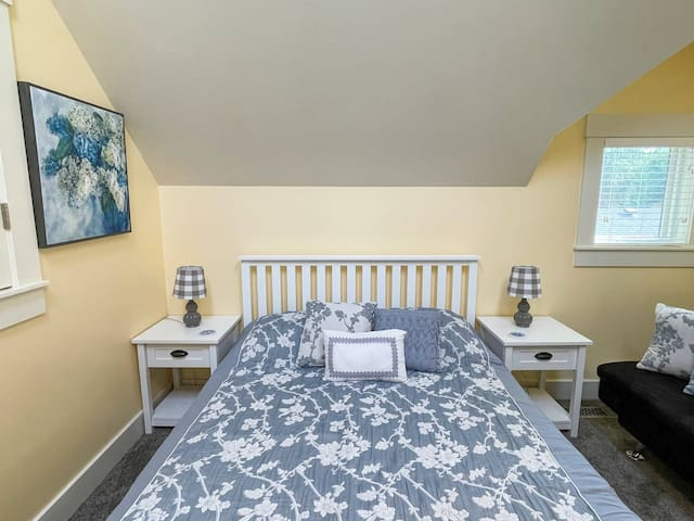 Bedroom 2 with queen bed, twin Click-Clack sofa bed and also has closable windows that overlook living area.