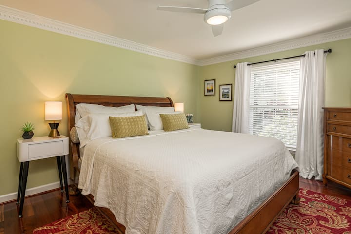 Main Floor Primary bedroom offers Sleigh King Bed, side tables and reading lamps, bureau and large closet.