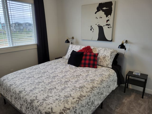Queen bed, 2 clock radios, blackout curtains, reading lamps