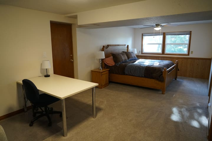 Downstairs suite with desk, loveseat, king sized bed and in-suite bath.  Can be closed off from the rest of the house.