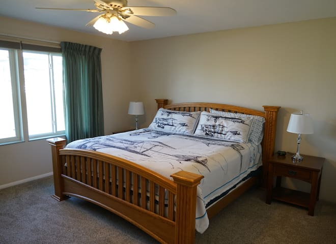 Master bedroom with in-suite bath and king sized bed.