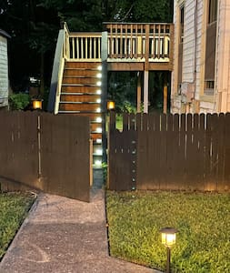 Lit pathway to entryway